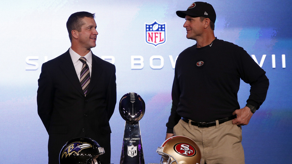 San Francisco 49ers head coach Jim Harbaugh (right) and his brother, Baltimore Ravens head coach John Harbaugh, with the Vince Lombardi trophy ahead of the NFL's Super Bowl XLVII in New Orleans. (Reuters /Landov)