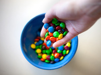 When times are tough, that prehistoric urge to splurge on high-calorie treats like M&Ms still kicks in.