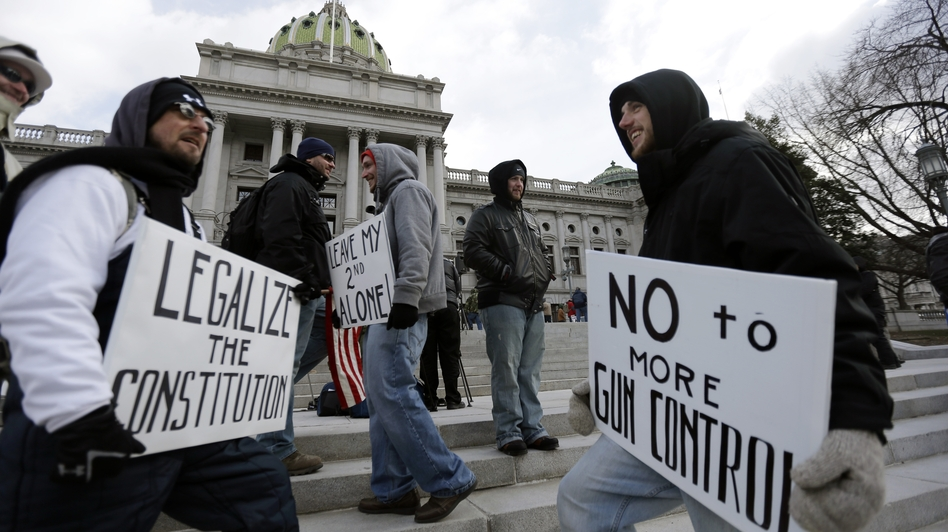 Gun rights advocates demonstrate at the capitol in Harrisburg, Pa., on Wednesday as vendors pulled out of the city's Eastern Sports and Outdoor Show. Vendors were upset that the organizers of the event banned the sale and display of certain types of guns.