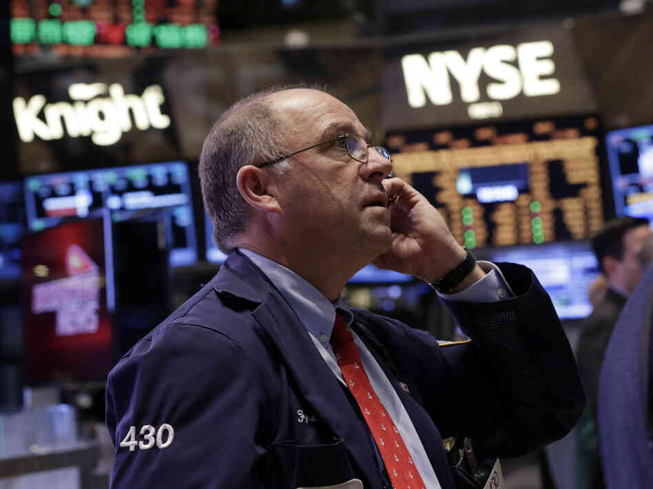 Trader Frederick Reimer works on the floor of the New York Stock Exchange on Friday.
