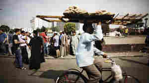 Dodging Clashes, Cairo's Deliverymen Take Big Risks