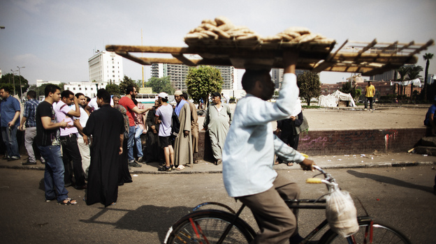 An Egyptian man delivering bread rides through Cairo's Tahrir Square last year. Couriers are taking great risks as they work around Egypt's capital. (AFP/Getty Images)