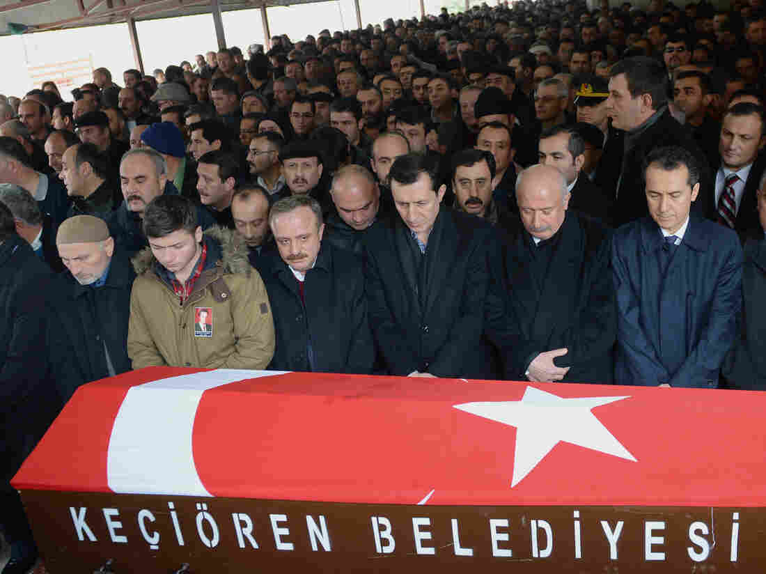 Mourners gather in Ankara on Saturday by the coffin of Mustafa Akarsu, who was killed in the attack on the U.S. Embassy in Turkey's capital on Friday.
