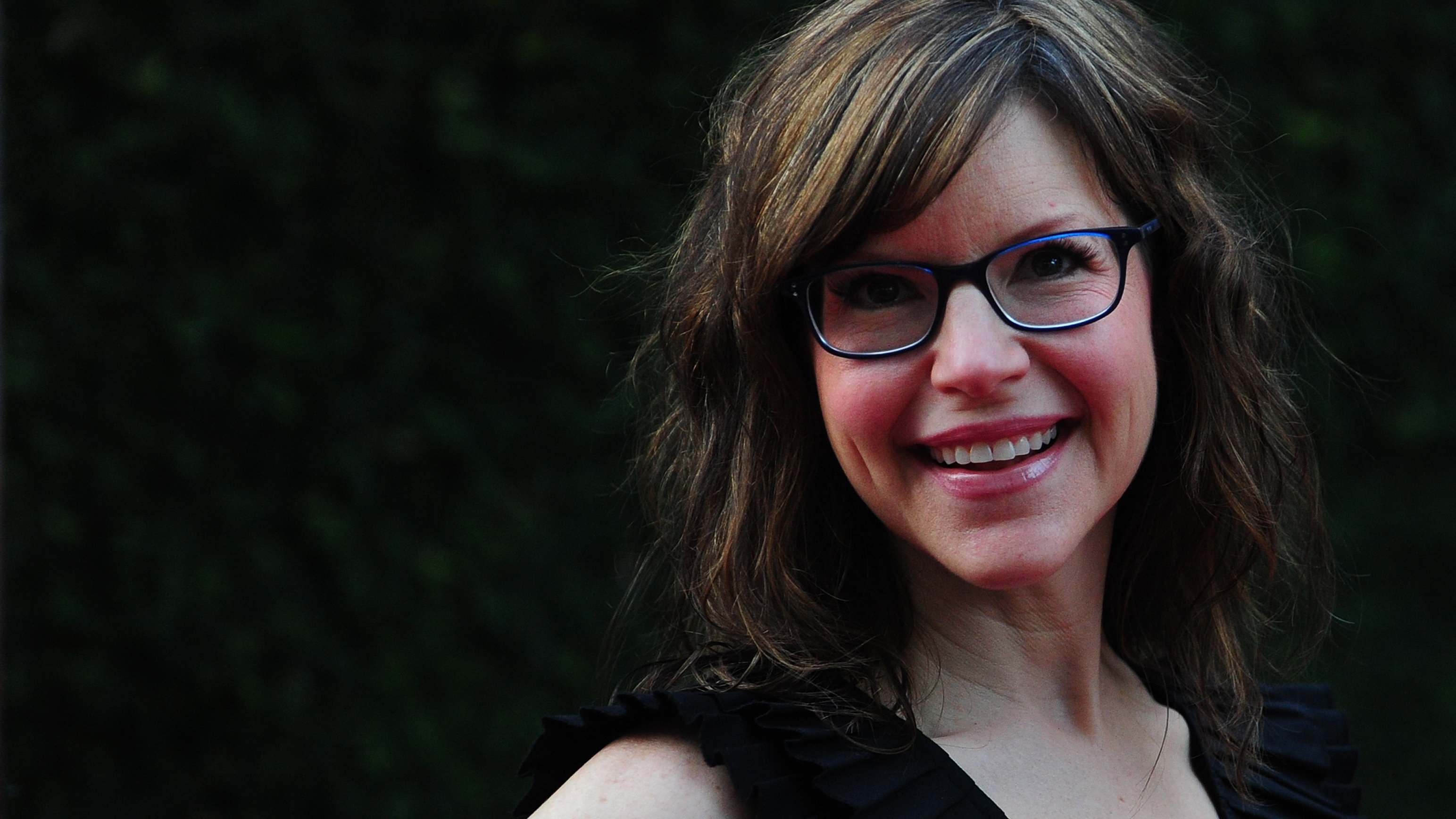 Lisa Loeb poses for the cameras on arrival for a Special Screening of DreamWork's Pictures' Fright Night on Aug. 17, 2011, in Hollywood, Calif.