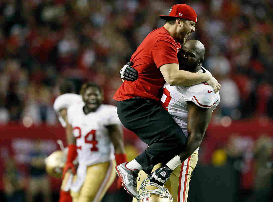 Practice squad player Nate Stupar and guard Leonard Davis of the San Francisco 49ers celebrate during the NFC Championship game on January 20.