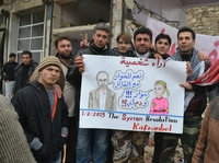 In this poster seen in Kafr Nabl, Syria, a likeness of Syrian activist Moaz al-Khatib says: