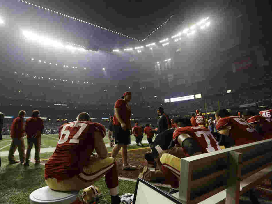 San Francisco 49ers offensive lineman Daniel Kilgore (67) waits on the bench during a power outage during the second half of the Super Bowl Sunday.