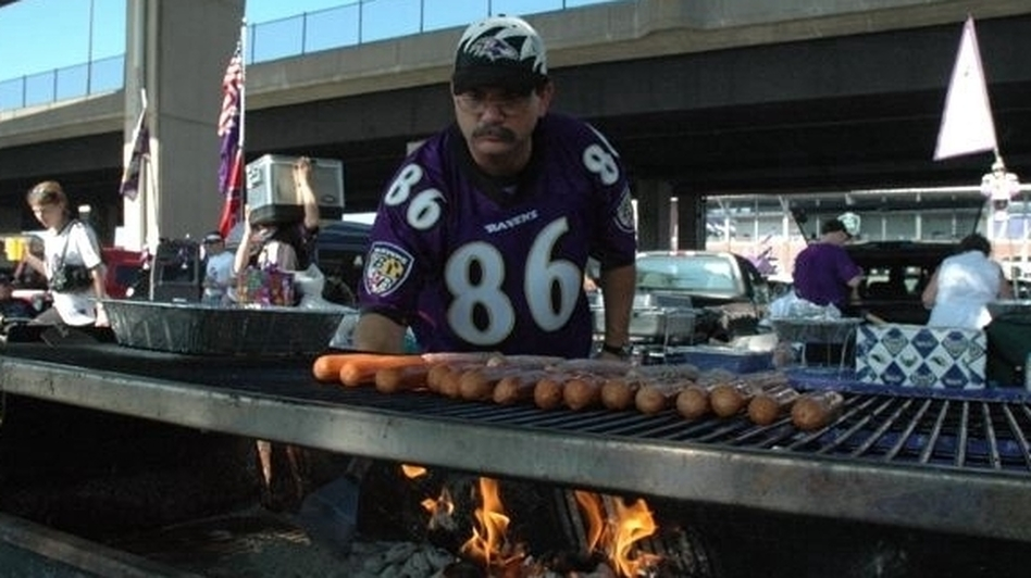 Ravens fan Michael Neapolitan at the grill after he's burned the opposing team's football cards. (Michael Neapolitan)