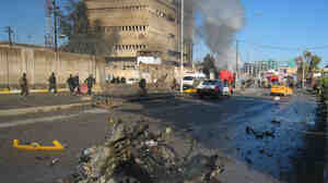Iraqi security forces inspect the scene of a bombing in Kirkuk, 180 miles north of Baghdad on Sunday.