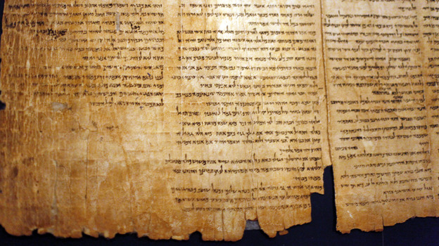 A part of the Isaiah Scroll, one of the Dead Sea Scrolls, is seen inside the vault of the Shrine of the Book building at the Israel Museum in Jerusalem. (Getty Images)