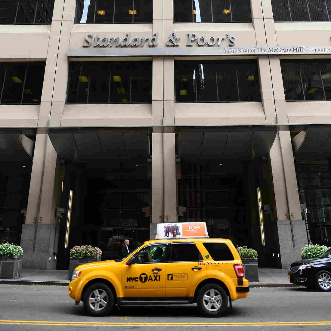 A sign for Standard & Poor's rating agency stands in front of the company headquarters in New York.