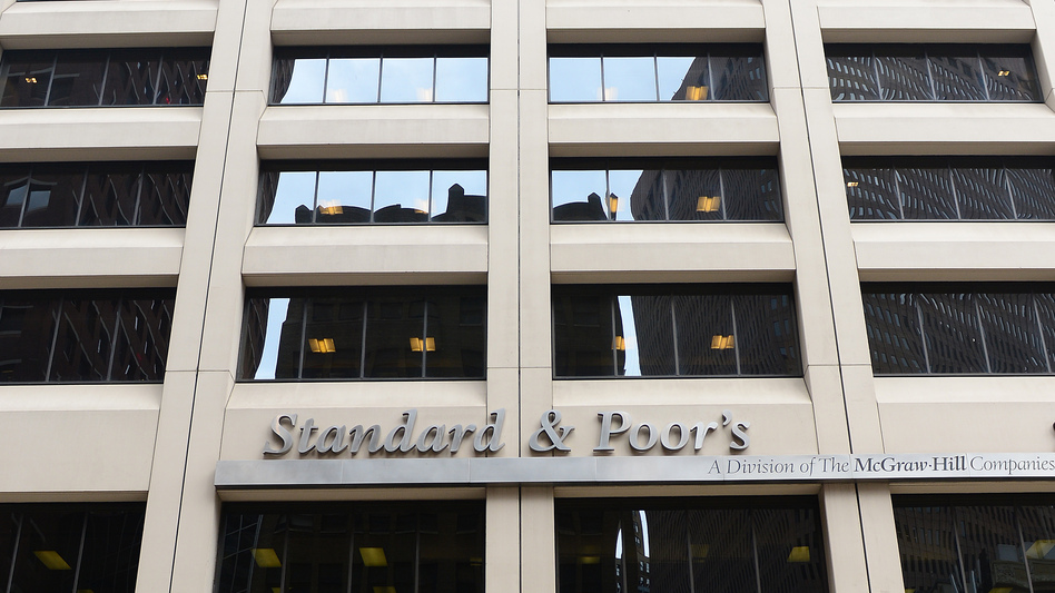 A sign for Standard & Poor's rating agency stands in front of the company headquarters in New York. (AFP/Getty Images)