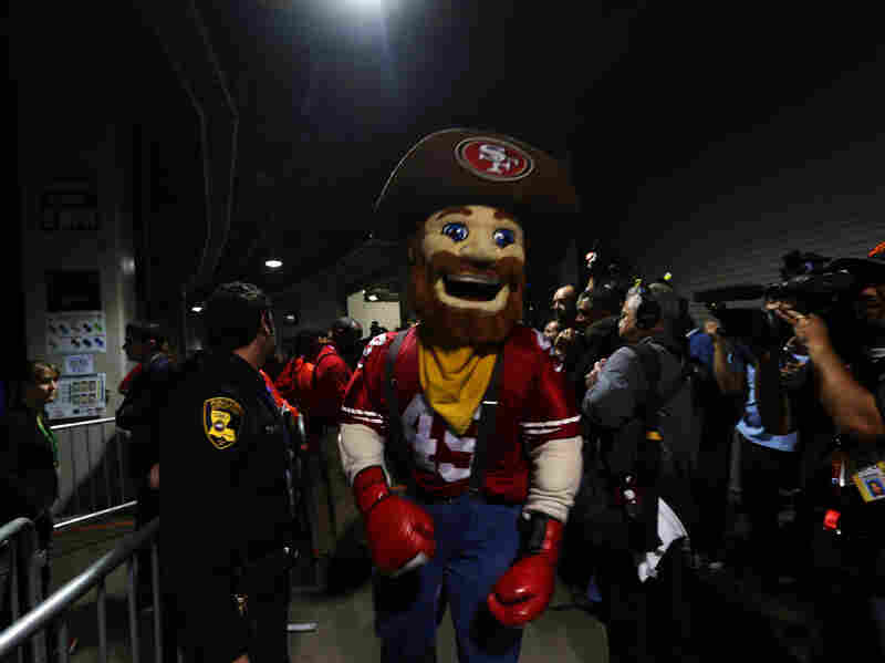 "The San Francisco 49ers mascot stands in the tunnel during the power outage. Please imagine his instructions: ""Even in case of emergency, the foam head STAYS ON."""