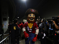 The San Francisco 49ers mascot stands in the tunnel during the power outage. Please imagine his instructions: