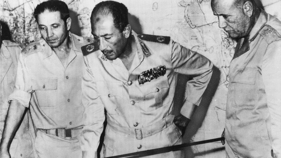 Egyptian President Anwar Sadat is flanked by senior military officers as he reviews maps of battlefield developments in the 1973 Arab-Israeli War. He's shown at army headquarters in Cairo on Oct. 15, 1973. Egypt and Syria attacked Israel, catching Israel and the CIA off-guard. (AP)