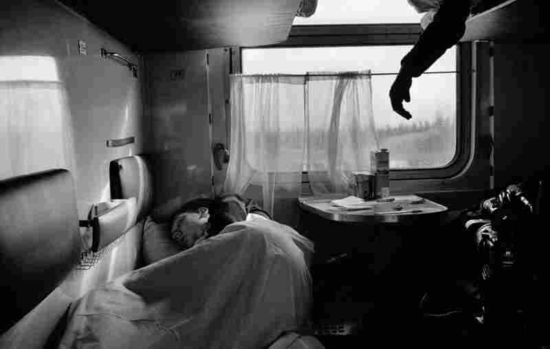 A young coal miner sleeps on the train. The ride from Moscow to the coal mines in the Arctic Circle can take 40