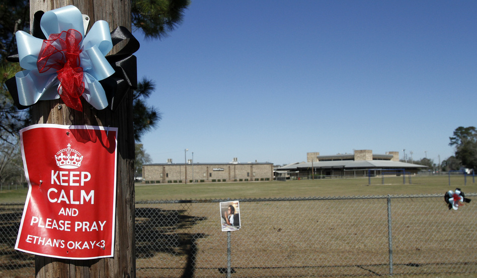 Posters for Ethan decorate power poles all over town, like this one outside the elementary school in Midland City, Ala.