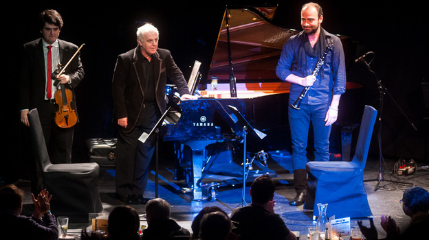 Conductor and pianist Daniel Barenboim (center) brought members of his West-Eastern Divan Orchestra (including his son Michael Barenboim, left, and Kinan Azmeh) to the intimate spaces of Manhattan's Le Poisson Rouge. (Ryan Muir for NPR)