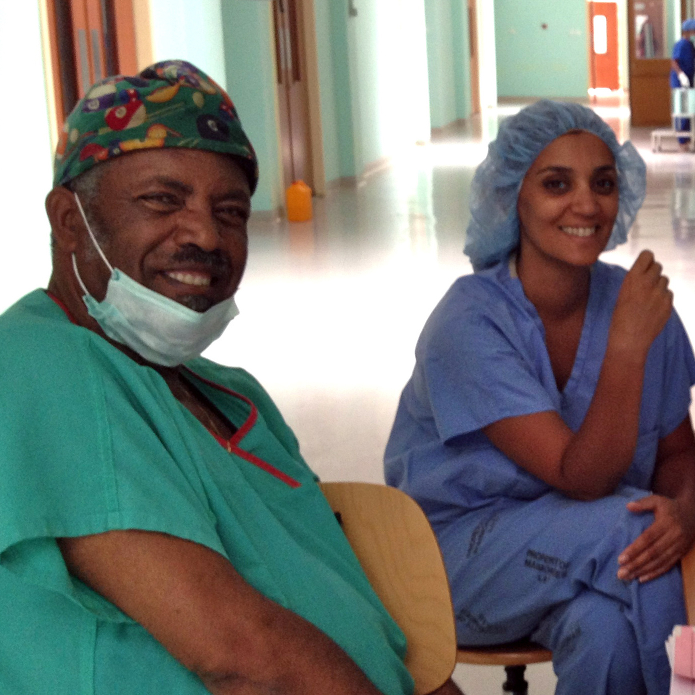 Dr. Ambereen Sleemi (second from the left) traveled to Eritrea to help start an obstetrics training program. Here she relaxes in the new ward with Dr. Haile Habte Melecot (from left), a resident student and Dr Dawit Sereke.