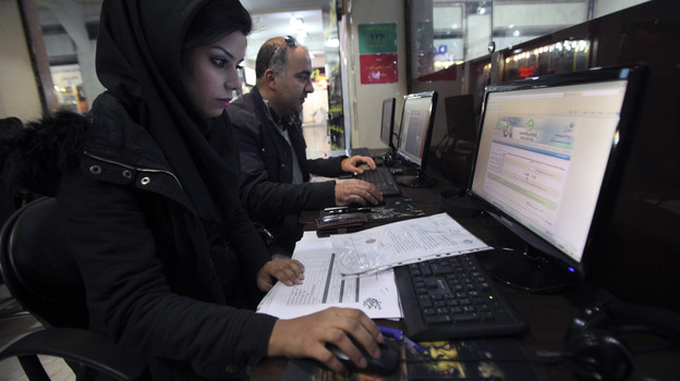Iranian authorities are using cyberpolice units to crack down on people who try to access banned websites, including social media sites such as Facebook. Here, Iranians use computers at an Internet cafe in Tehran in January. (AP)