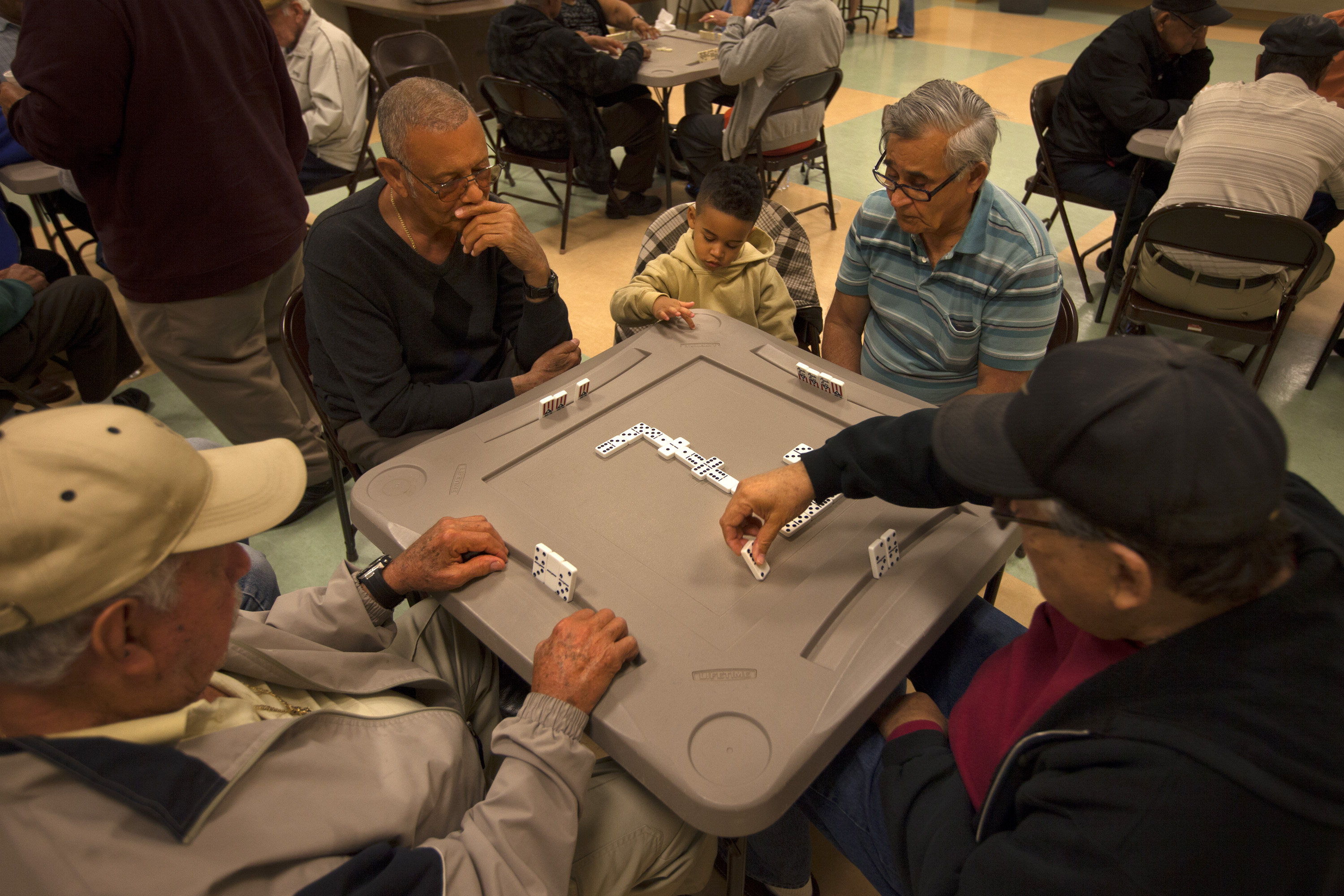 A group of men plays dominoes at the Robert Guevara Community Center in the heart of the Buenaventura Lakes neighborhood in Kissimmee. Today, Florida has replaced New York as the primary destination for Puerto Ricans coming to the mainland.