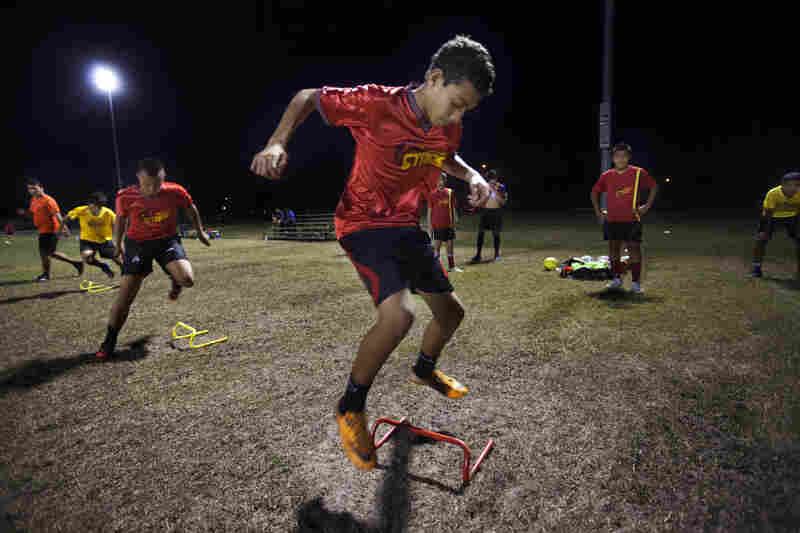 Louis Jimenez, 14, attends soccer practice for his team, the Orlando Stars, at the Archie Gordon Memorial Park in Kissimmee.