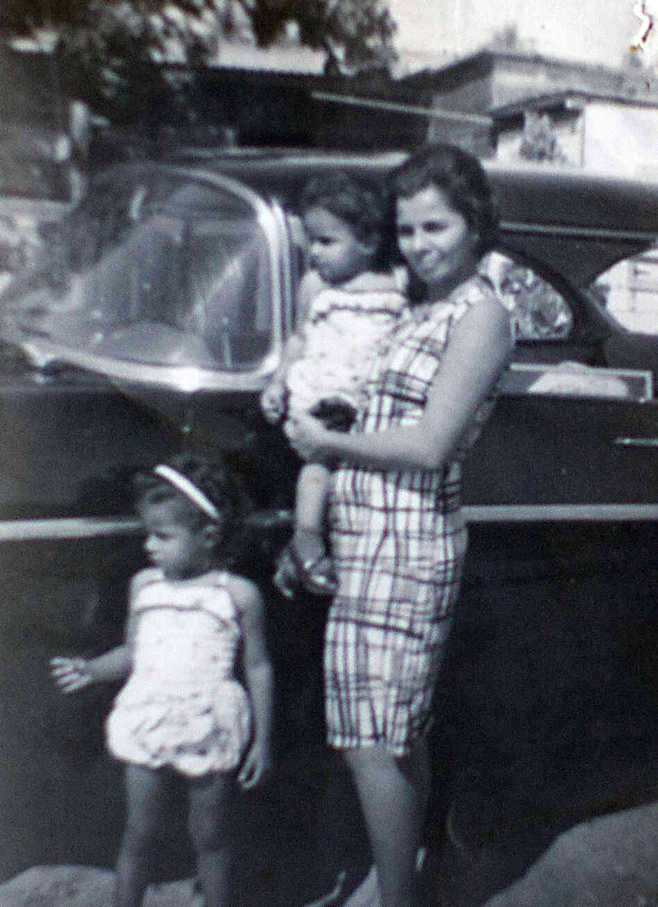 In this family photo, Arlene Bonet and her younger sister Genoveva are seen with their mother, also named Genoveva, in Puerto Rico.