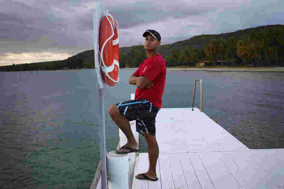 "Edward Bonet, 23, lives in Cabo Rojo, Puerto Rico, and works on the dive team at the Copamarina Beach Resort & Spa in the town of Guanica. He lives with his grandmother, Genoveva ""Veva"" Camacho."