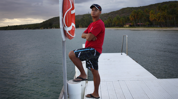 Edward Bonet, 23, lives in Cabo Rojo, Puerto Rico, and works on the dive team at the Copamarina Beach Resort & Spa in the town of Guanica. He lives with his grandmother, while his mother and sister live in Central Florida. (NPR)