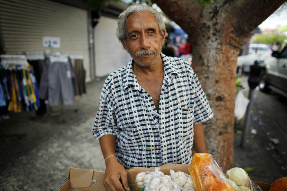 Miguel Sanchez sells fruits and vegetables on the street in Rio Piedras.  (NPR)