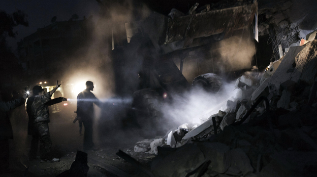Syrians look for survivors amid the rubble of a building targeted by a missile in the al-Mashhad neighborhood of Aleppo on Jan. 7. (Getty Images)