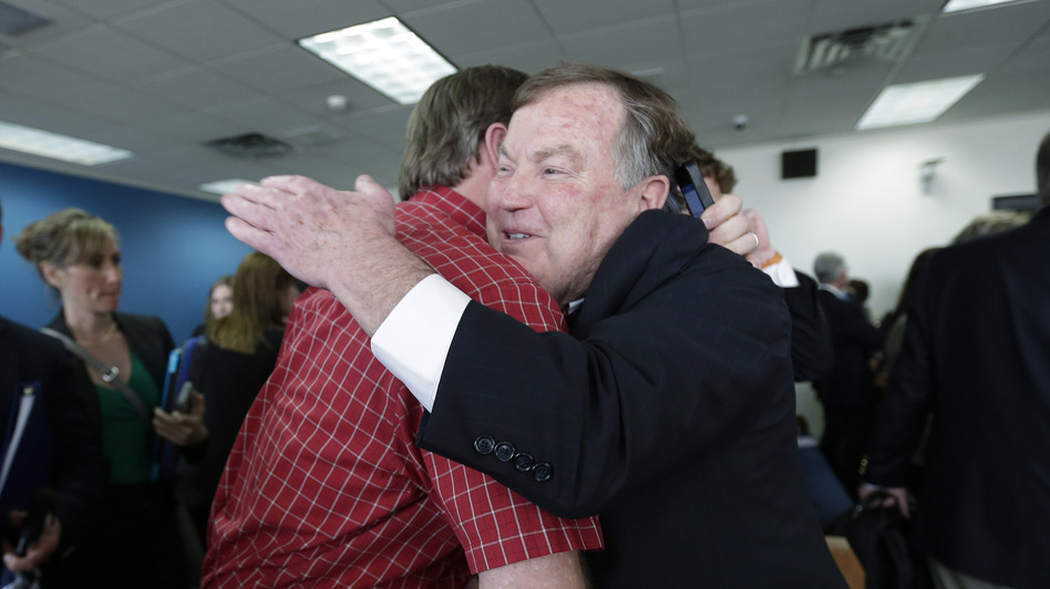 Attorney Rick Gray, representing more than 400 districts mostly in poorer areas of the state, is congratulated Monday in Austin following a ruling in a consolidated six-lawsuit case contending the school finance system violates the Texas Constitution.