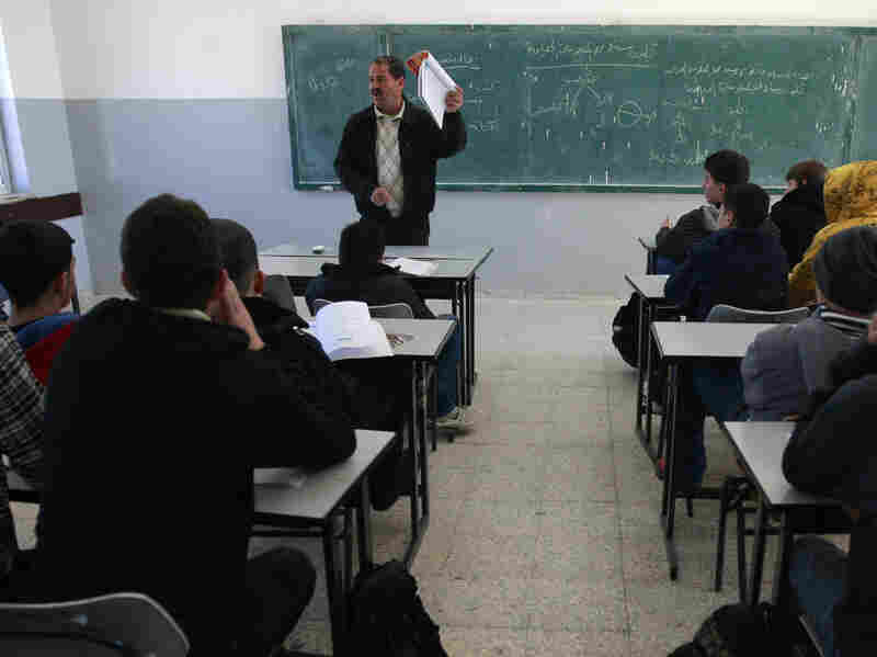 Palestinian students attend a class in the West Bank city of Ramallah on Sunday.