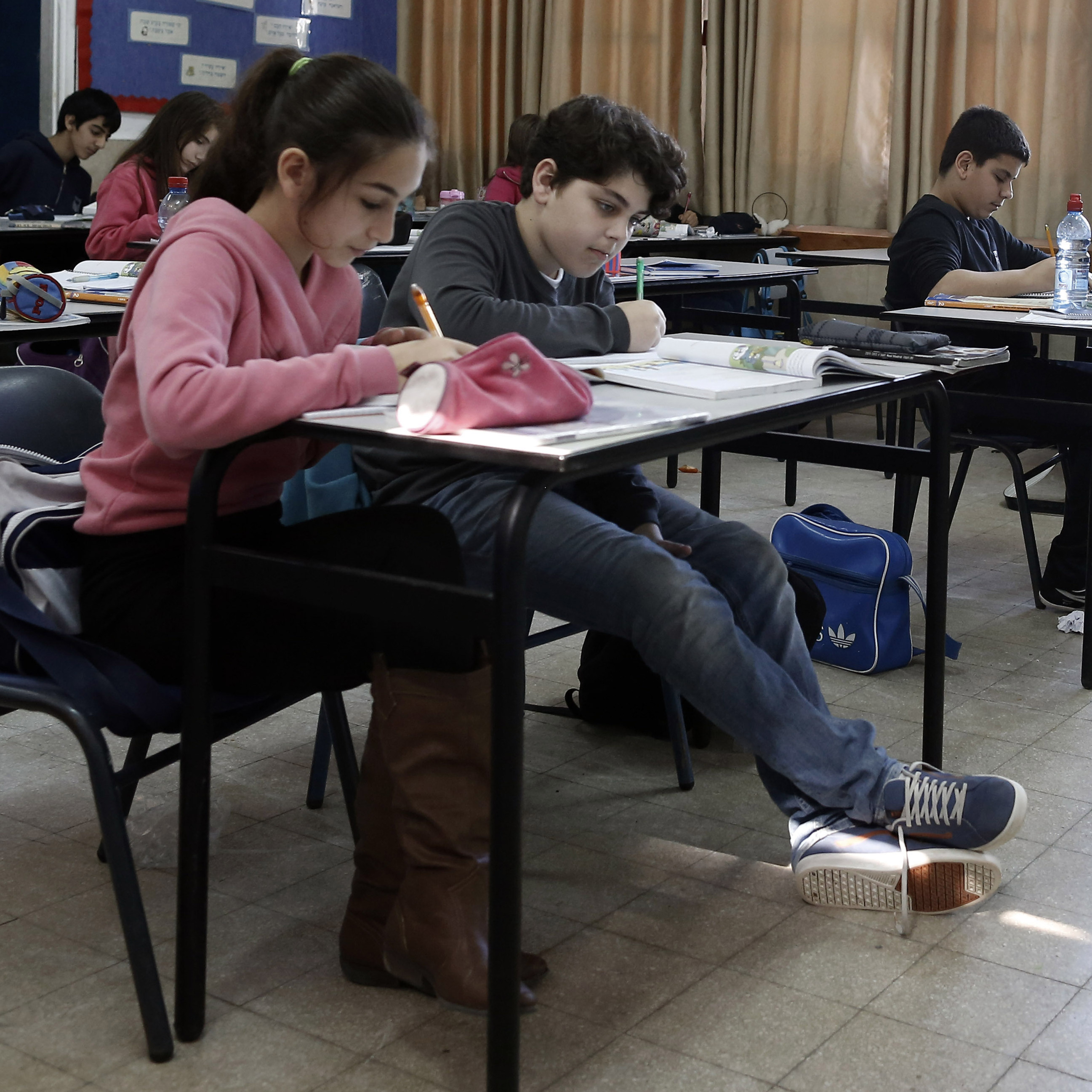 Israeli students attend class at an elementary school in the coastal city of Ashkelon. A U.S.-funded study released Monday said both Israeli and Palestinian textbooks present largely one-sided narratives of their conflict but rarely resort to demonization of the other side.