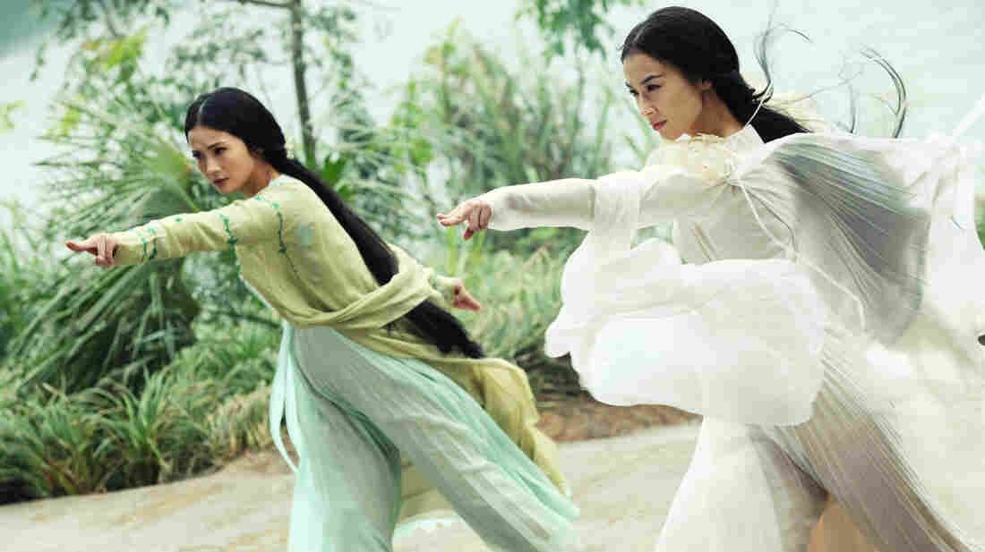 The demon snake sisters (Charlene Choi and Eva Huang) disguise themselves as beautiful women in The Sorcerer and the White Snake.