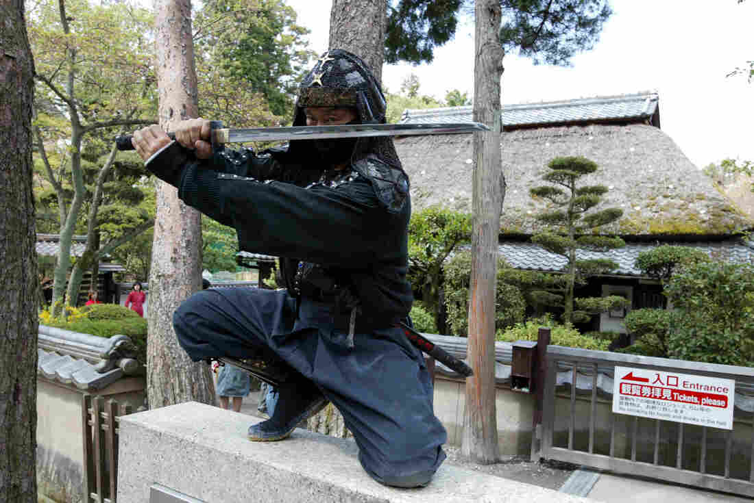 An authentic master of ninjutsu martial art, Kazuki Ukita poses in Ninja costume at the Ninja museum's Ninja residence in the small ancient city of Ueno.