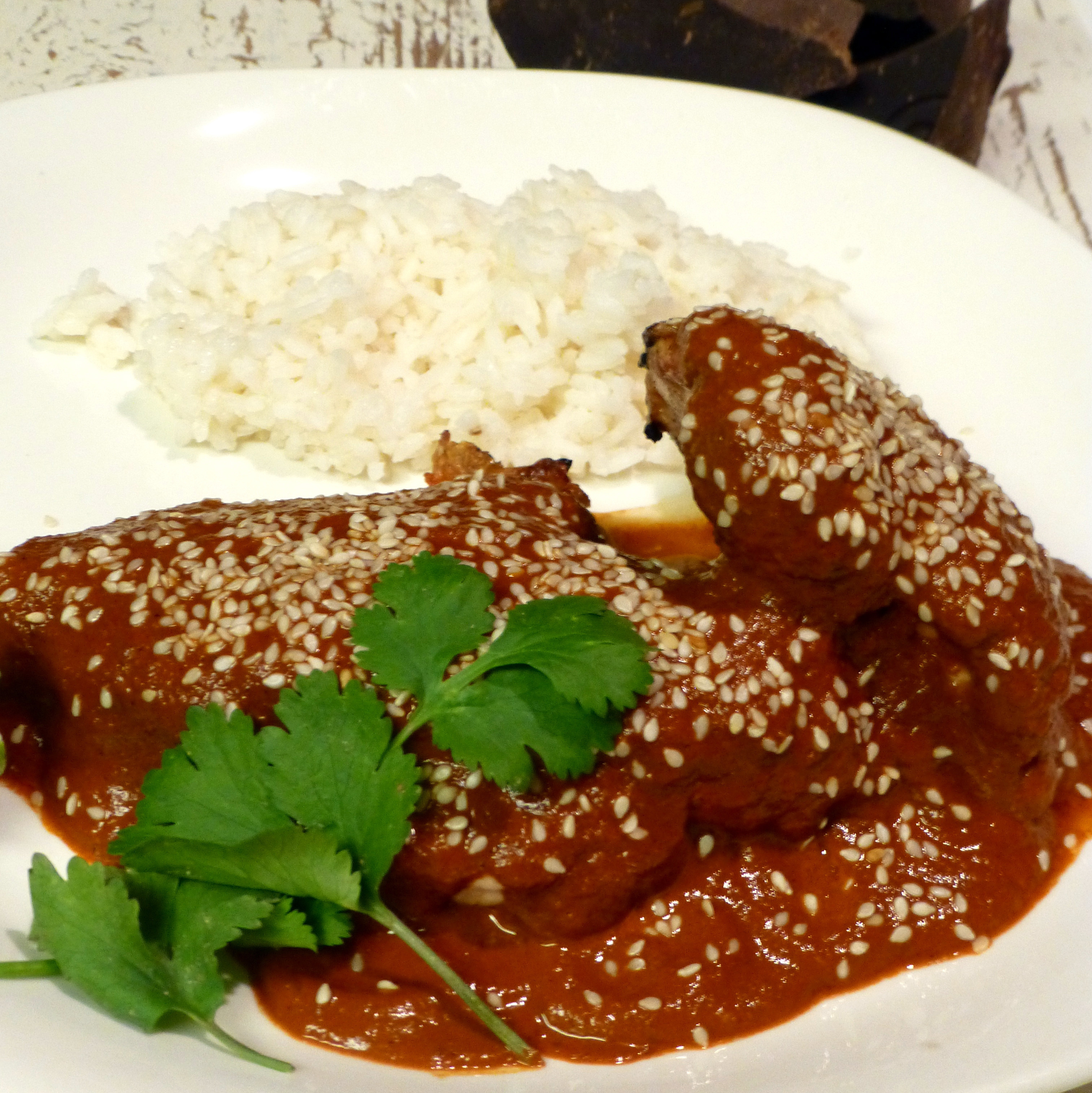 Here, Chocolate Mole is served over grilled chicken. But it's also commonly paired with pork