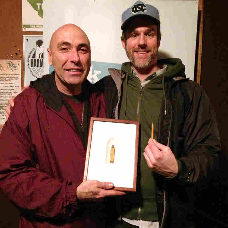 V.I.P. David Rees (right) and artist Dalton Ghetti. Ghetti brought one of his pieces to the show, a tiny boot he carved into the tip of a carpenter's pencil.