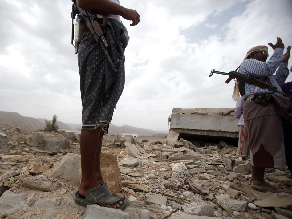 October 2011: Men stand on the rubble of a building destroyed by a U.S. drone  strike in southeastern Yemen. Among those killed was U.S. citizen  Abdulrahman al-Awlaki, the son of U.S.-born cleric Anwar al-Awlaki — who  himself was killed by a drone strike the month before.