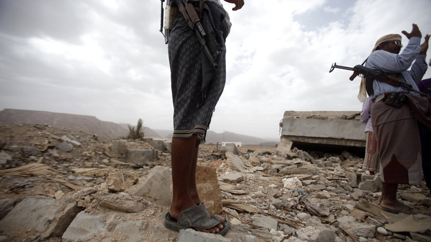 October 2011: Men stand on the rubble of a building destroyed by a U.S. drone  strike in southeastern Yemen. Among those killed was U.S. citizen  Abdulrahman al-Awlaki, the son of U.S.-born cleric Anwar al-Awlaki — who  himself was killed by a drone strike the month before. (Reuters /Landov)