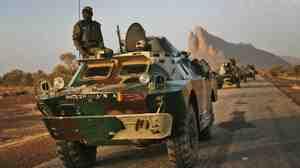 Malian troops near Hambori, northern Mali are driving toward Gao on Monday, Feb. 4, 2013.