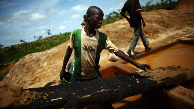 A boy works at an illegal gold mine in northern Nigeria. Lead from these mines has sickened thousands of children in region. (NPR)