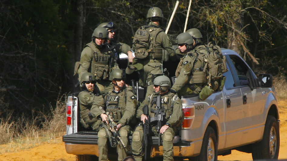 Law enforcement officials, including some from the FBI, near the scene of the hostage situation in Midland City, Ala., on Friday. (Reuters /Landov)
