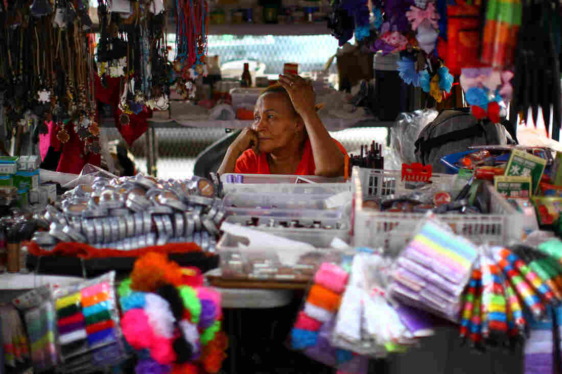 Daysi Pena has sold cosmetics and accessories in San Juan, Puerto Rico, for 12 years. She is now thinking of moving to New York to escape the escalating violence on the island. There was a shooting one block from her stall a day before this photo was taken.
