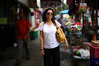 Rosario Rivera is an economist and professor at the University of Puerto Rico. She lives on the island with her husband, a lawyer, but they've considered moving to the mainland. She is seen here at a street market in the Rio Piedras neighborhood of San Juan.