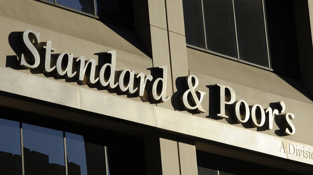 In a lawsuit, the Justice Department alleges Standard and Poor's misled investors with fraudulent credit ratings. The agency could seek more than $5 billion in damages. (AP)