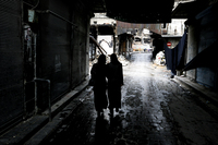 Syrian women walk through a market area in the northern city of Aleppo last November. A new website is documenting the use of rape in the Syrian conflict.