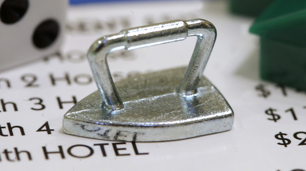 The Monopoly iron token that was replaced by the new cat token. (AP)