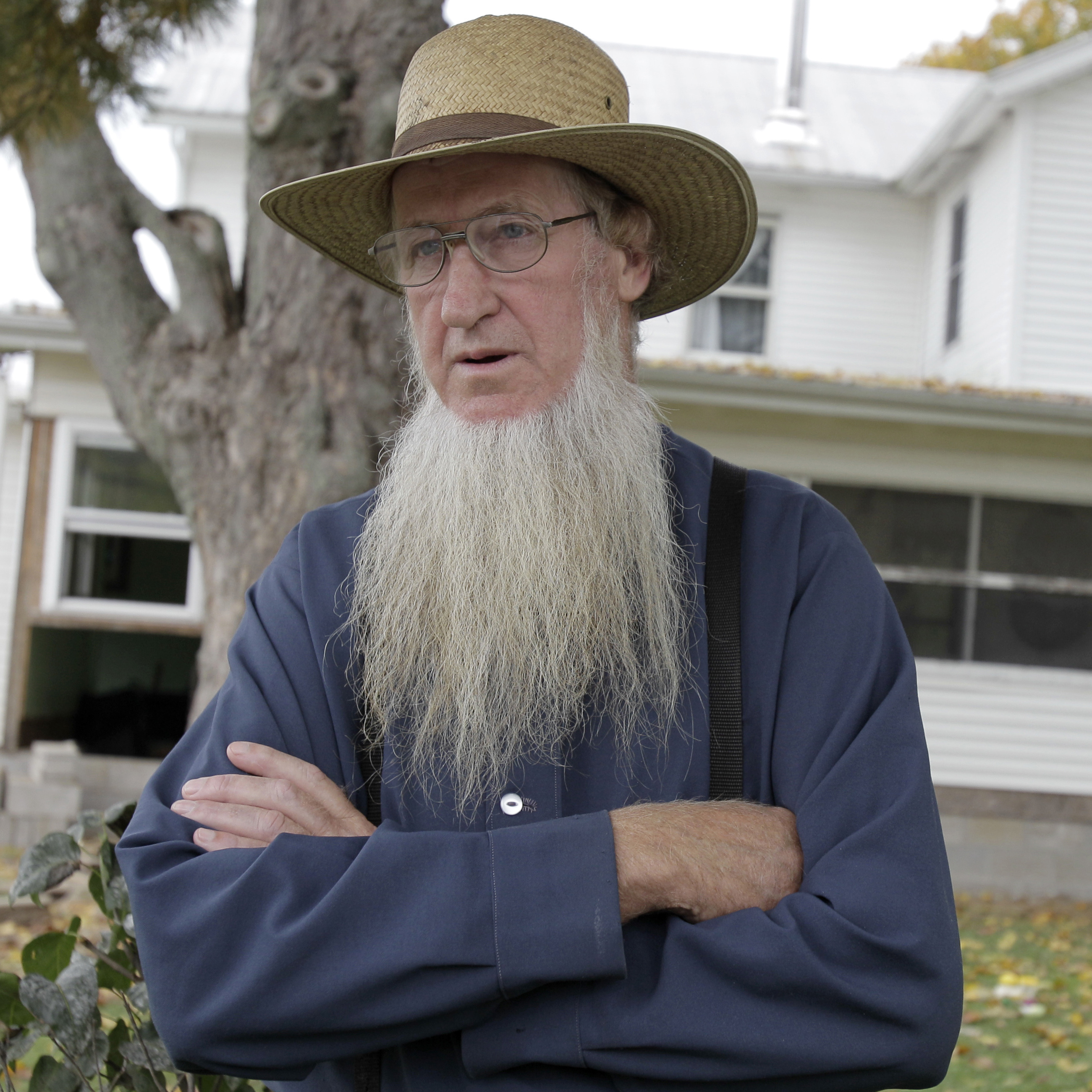 Amish bishop Samuel Mullet stands in front of his home in Bergholz, Ohio. He was found guilty of masterminding a plan to cut off beards and hair of other Amish.