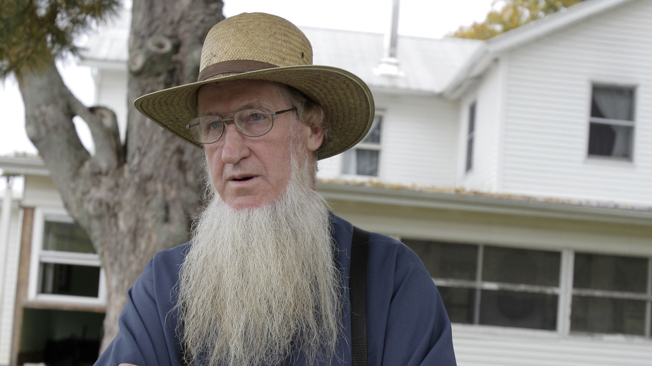 Amish bishop Samuel Mullet stands in front of his home in Bergholz, Ohio. He was found guilty of masterminding a plan to cut off beards and hair of other Amish. (AP)